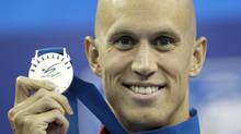 Canada's Brent Hayden poses with the silver medal he won in the men's 100m Freestyle final at the FINA Swimming World Championships in Shanghai, China, Thursday. (Michael Sohn/Associated Press)