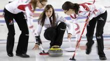 Canada's skip Rachel Homan (C) watches a stone during their World Women's Curling Championship play-off match against the United States, in Riga March 23, 2013. (INTS KALNINS/REUTERS)