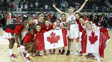 Canada's players pose for a photo as they celebrate their victory against Japan during their 2012 women's FIBA Olympic Qualifying Tournament in Ankara July 1, 2012. (UMIT BEKTAS/REUTERS)