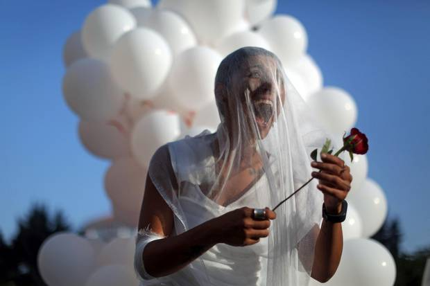 An activist celebrates in Beirut on Aug. 17, 2017, after the abolishment of the article 522 in the Lebanese code, which shields rapists from prosecution on the condition that they marry their victim.