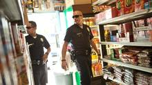 "Jake Gyllenhaal and Michael Peña in a scene from ""End of Watch"" (Scott Garfield)"