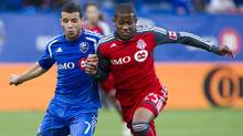 Montreal Impact midfielder Felipe Martins (7) battles Toronto FC defender Jeremy Hall (25) during first half Major League Soccer action Wednesday, June 27, 2012 in Montreal. (The Canadian Press)
