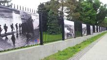 Two photo banners, second and third from the left,, from an exhibition paying tribute to the Canadian soldiers who took part in the 1944 Normandy landings have been stolen from in front of the French Embassy in Ottawa. Embassy spokesman Stephane Schorderet says the banners were taken Tuesday afternoon by two young men and a young woman who drove up in a black pickup truck. (HO/THE CANADIAN PRESS)