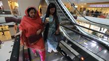 Shoppers ride an escalator at the Centaurus, a new mall in Islamabad. The project is a potential target for terrorism. (Zohra Bensemra/REUTERS)