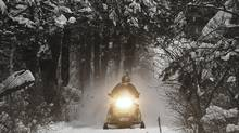 Snowmobilers, including some 30,000 tourists from outside the province, spent $940-million in 2011 to zoom around on Quebec's 32,000 km of trails. (Toby Talbot/AP)
