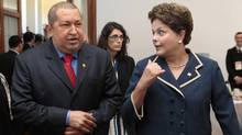 Venezuela's President Hugo Chavez and Brazil's President Dilma Rousseff chat during the Mercosur trade block summit in Montevideo, Uruguay, Dec. 20, 2011. (HANDOUT/Reuters)