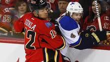 St. Louis Blues' Kris Russell (R) is hit by Calgary Flames' Jarome Iginla during the first period of their NHL hockey game in Calgary, Alberta, March 24, 2013. (TODD KOROL/REUTERS)