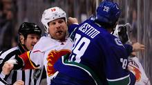 Calgary Flames forward Brian McGrattan and Vancouver Canucks forward Tom Sestito fight in the first 2 seconds of the first period at Rogers Arena. (USA Today Sports)
