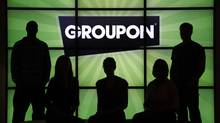 Groupon is expected to report its fiscal second-quarter Monday. Groupon is coming off a better-than-expected first fiscal quarter, but its otherwise disappointing performance since going public in November has sent its stock price tumbling. (Charles Rex Arbogast/AP)