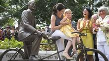 Jack Layton's daughter Sarah, granddaughter Beatrice and widow Olivia Chow share a laugh as a statue in memory of the late NDP leader was unveiled in Toronto on Aug. 22, 2013. (Kevin Van Paassen/The Globe and Mail)