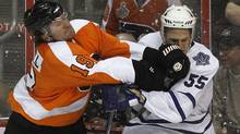 Philadelphia Flyers winger Scott Hartnell (19) checks Toronto Maple Leafs defenseman Korbinian Holzer (55) during the first period of their NHL preseason hockey game in Philadelphia, Pennsylvania, September 21, 2011. (TIM SHAFFER/Reuters)