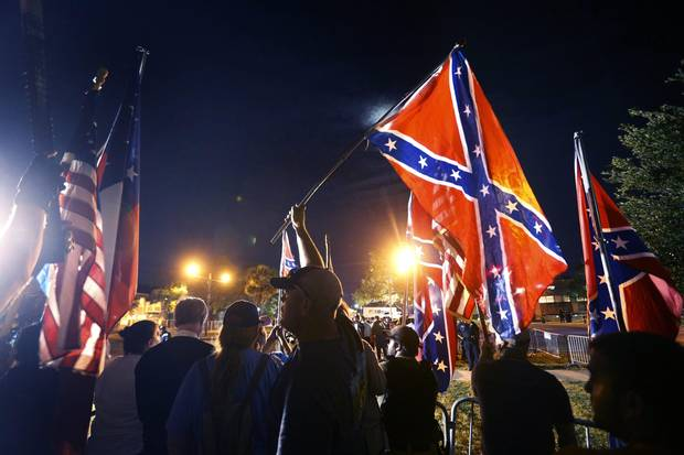 Demonstrators who supports keeping Confederate era monuments protest before the Jefferson Davis statue was taken down in New Orleans, Thursday, May 11, 2017.