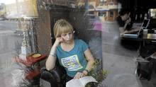 Jazz singer Sophie Milman in her favourite place to read, The Mad Bean Cafe on Eglinton Ave. West in Toronto. (Fred Lum/Fred Lum/The Globe and Mail)