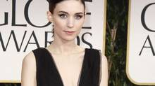 "Actress Rooney Mara from the film ""The Girl with the Dragon Tattoo"" arrives at the 69th annual Golden Globe Awards in Beverly Hills, California January 15, 2012. (DANNY MOLOSHOK/REUTERS/Danny Moloshok)"