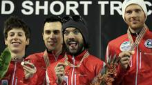 Canada's team Michael Gilday, Charles Hamelin, Olivier Jean and Charle Cournoyer celebrate on the podium after the men's 5000m relay final at the ISU World Short Track Speed Skating Championships in Debrecen March 10, 2013. (LASZLO BALOGH/REUTERS)