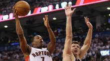Toronto Raptors point guard Kyle Lowry goes to the basket against the Brooklyn Nets in game one during the first round of the 2014 NBA Playoffs at Air Canada Centre in Toronto on April 19. (Tom Szczerbowski/USA TODAY Sports)