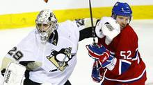 Montreal Canadiens' Mathieu Darche gets a glove in the face from Pittsburgh Penguins goalie Marc-Andre Fleury during second period of Game 4 NHL Eastern Conference semi-finals hockey action Thursday, May 6, 2010, in Montreal. (Paul Chiasson/THE CANADIAN PRESS)