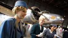 Air Canada co-workers, left to right, Lyn Wilson (in an early 1950's uniform), Kamla Buckle (in the 1964-68 uniform), and Nadia D'Amico (the 1954-63 uniform) in front of Air Canada's first ever aircraft, the vintage 1937 Lockheed L10A Electra, on display at the event in Toronto where the airline's newest aircraft, the Boeing 787 Dreamliner, was on display in an adjacent hangar as part of the company's 75th Anniversary Year celebrations. (Peter Power/The Globe and Mail/Peter Power/The Globe and Mail)