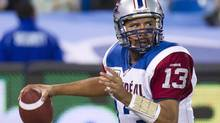 Montreal Alouettes quarterback Anthony Calvillo throws the football against the Toronto Argonauts during first half CFL football action in Toronto on Sunday, Oct. 14, 2012. (Nathan Denette/THE CANADIAN PRESS)