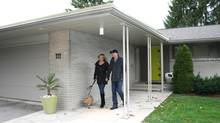 The Stadus family, dedicated mid-century modern aficionados, here outside their Waterloo, Ont., mid-century modern bungalow. Left to right, Monty, a two-year-old Norwich terrier, Mary and R.J. (Dave LeBlanc For The Globe and Mail)