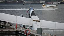 A plane belonging to Harbour Air lies partially submerged at the new dock facilities at the float plane terminal in Vancouver on November 5th, 2011. Questions have been previously raised about the new site's exposure. (Simon Hayter for The Globe and Mail/Simon Hayter for The Globe and Mail)
