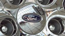 File photo of a Ford logo is displayed on a wheel at a car dealership in Omaha, Neb. (Nati Harnik/AP)