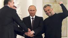 Russian President Vladimir Putin (2nd R), Crimea's Prime Minister Sergei Aksyonov (front L), Crimean parliamentary speaker Vladimir Konstantinov (back L) and Sevastopol Mayor Alexei Chaliy shake hands after a signing ceremony at the Kremlin in Moscow March 18, 2014. (Sergei Ilnitsky/REUTERS)
