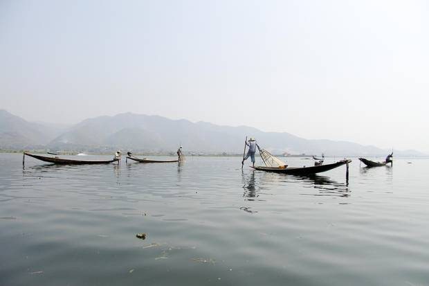 Inle Lake's famed traditional fisherman look for a catch in the late afternoon.