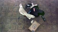This April 1994 photo provided by the Seattle Police Department shows items found at the scene of Kurt Cobain's suicide, in Seattle. The image has never before been released. Police spokeswoman Renee Witt said Thursday, March 20, 2014, that several rolls of undeveloped film were found when a detective re-examined the Cobain case recently. (Uncredited/AP)