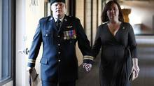 Canadian Forces Major Christopher Lunney arrives with his wife Colleen for the start of hearings on the first day of his court martial in Gatineau, Quebec September 13, 2012. (CHRIS WATTIE/REUTERS)