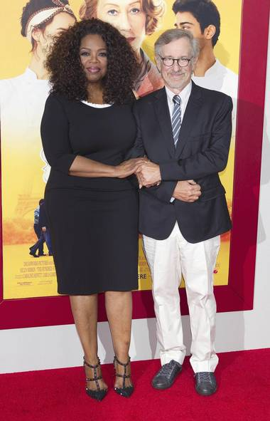 Welcome back to the celebrity summer that never ends. First stop: New York, where Oprah Winfrey and Steven Spielberg showed up at the premiere of their co-produced film The Hundred-Foot Journey, just like regular folk (CARLO ALLEGRI/REUTERS)