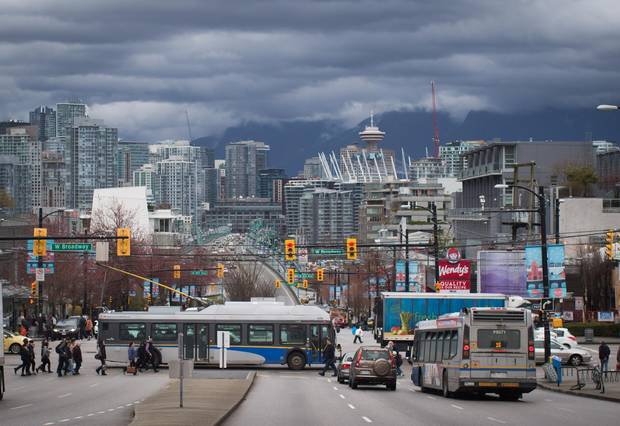 A TransLink bus travels on West Broadway in Vancouver, B.C., on Wednesday March 22, 2017.