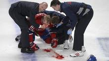 Montreal Canadiens' Lars Eller tended to following a hit by Ottawa Senators' Eric Gryba (not shown) during second period of game one first round NHL Stanley Cup playoff action in Montreal, Thursday, May 2, 2013. (Graham Hughes/THE CANADIAN PRESS)