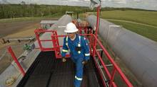 Foreman Ron Toly inspects the carbon capturing research facility near Redwater, Alta., on Friday, June 26, 2009. (John Ulan)