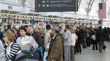 U.S.-bound travellers line up at Toronto's Pearson airport. (FRANK GUNN)