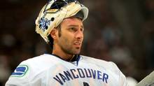 Goaltender Roberto Luongo of the Vancouver Canucks looks on during a break in the action against the Colorado Avalanche during NHL action at the Pepsi Center on October 3, 2009 in Denver, Colorado. Luongo had 24 saves while giving up three goals as the Avalanche defeated the Canucks 3-0. (Doug Pensinger/2009 Getty Images)