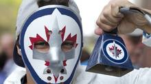 A Winnipeg Jets fan holds upa cowbell before the Jets inaugural game against the Montreal Canadiens at the MTS Centre in Winnipeg, Sunday, Oct. 9, 2011. THE CANADIAN PRESS/Jonathan Hayward (JONATHAN HAYWARD)