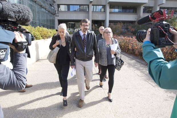 Nicole Walshe, daughter of Bret McCann; Bret McCann; and his wife Mary-Ann McCann leave the courthouse after Travis Vader was convicted of two counts of second-degree murder in the deaths of Lyle and Marie McCann.