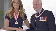 Celine Dion is elevated to Companion of the Order of Canada, by Governor General David Johston in Quebec City on Friday July 26, 2013. (JACQUES BOISSINOT/THE CANADIAN PRESS)