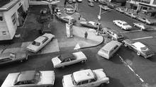 Cars line up in two directions on Sunday, Dec. 23, 1973, at a gas station in New York City. The gas station remained opened despite President Richard Nixon's plea for stations to close on Sundays. (MARTY LEDERHANDLER/AP)