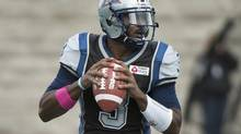 Montreal Alouettes' quarterback Troy Smith makes a play during first half CFL action against the Hamilton Tiger-Cats in Montreal, Sunday, October 20, 2013. (Graham Hughes/The Canadian Press)