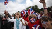 Fans of Great Britain cheer at the canoe sprint competition in Eton Dorney, near Windsor, England, at the 2012 Summer Olympics, Monday, Aug. 6, 2012. (Natacha Pisarenko/AP)