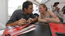 Sophie Brugman getting an autograph from IndyCar driver Justin Wilson who met nine children with dyslexia after Friday practice sessions for last weekend's Honda Indy Toronto. (Michael L. Levitt, LAT USA/Courtesy of Honda Racing)