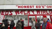 A large crowd of people waited in line, inside and out, to have a chance to purchase some of the many hand-made signs at Honest Ed's in Toronto on March 10, 2014. (Peter Power/The Globe and Mail)