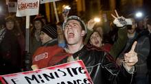 Students opposing tuition-fee hikes protest outside Quebec Premier Jean Charest's house in Montreal on Wednesday night. (Graham Hughes/The Canadian Press)