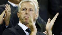 Newcastle United's manager Alan Pardew applauds from the stand before their English Premier League soccer match against Everton at Goodison Park in Liverpool, northern England, September 17, 2012. (Reuters)