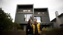 Mariana Brussoni and Nick Sully are photographed outside their 1,500-square-foot townhouse unit in Vancouver, British Columbia, Saturday, October 26, 2013. The townhouse unit is on land that traditionally would have been the site of a single-family detached home. (Rafal Gerszak for The Globe and Mail)