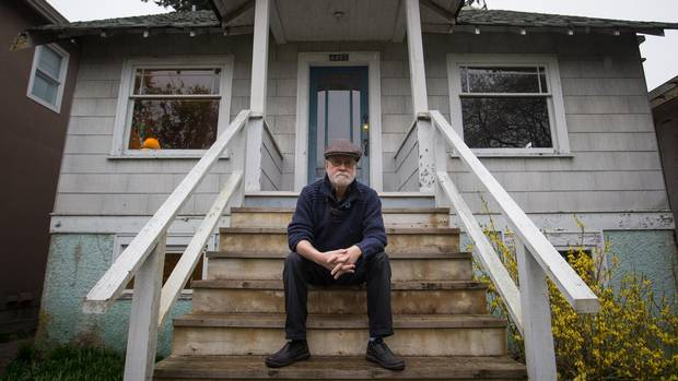 Ken Bryant on the steps of his 86-year-old home, which went viral when it was listed for $2.398-million and recently sold in Vancouver's west side.