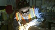 An employee welds some pipes at the ILevel plant in Kenora. (Tom Thomson For The Globe and Mail)