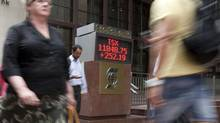 The sign outside Scotia Plaza in Toronto shows the closing numbers of the TSX on Tuesday, July 3, 2012. (Matthew Sherwood/The Globe and Mail)